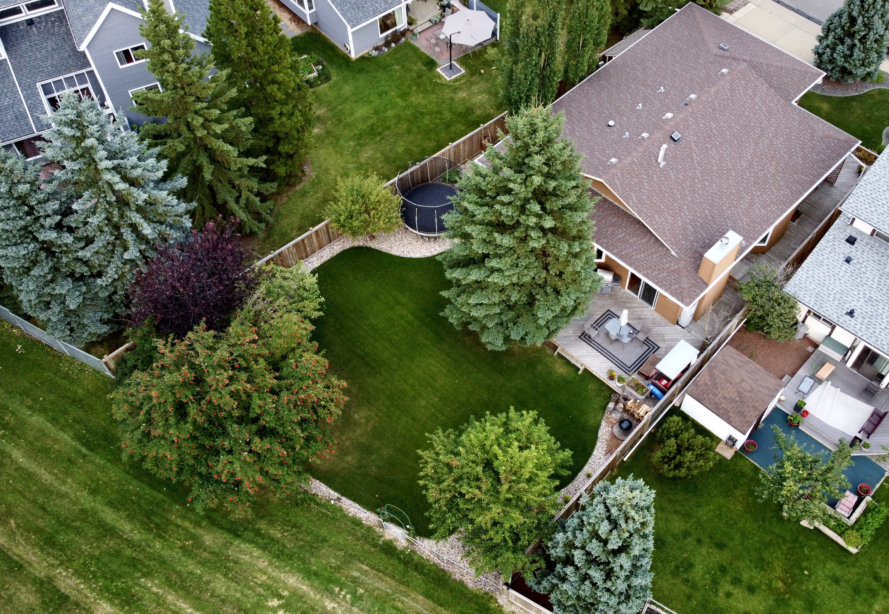 Aerial drone photography of backyard and parkland for real estate house for sale